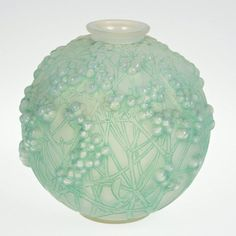 "R. Lalique ""Druides"" green patinated glass vase : Lot 1266"