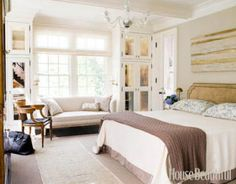 <p>Designer Frank DelleDonne designed the headboard and covered it in Royal Suede by Edelman Leather. Sferra bedding; Ralph Lauren blanket.</p>