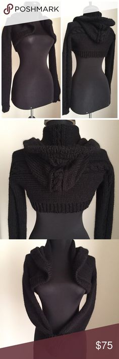 Black Shrug Hooded Cabled Knitted Ultra Cropped I make my shrugs a little different each time. This one has a nice thick folded band around the hood and front hem, ribbed back hem. The ribbed cuffs have finger holes. There is a bold classic twisted cable detail running along the sleeves, across the back, and up the center of the roomy hood. I might add a closure, but I don't think it needs it. 100% acrylic. It has been pre-washed so it's fuzzy, bouncy, and medium-thick. If you have…