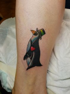 Penguin tattoo by Paul instagram.com/@jerzeydevil77