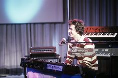 The British keyboards player Tony Banks smiling in front of a synthesizer Prophet 5. He having a role in the British musical band called Genesis. 1981