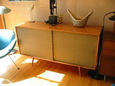 I have this Paul McCobb Credenza  with grasscloth panels. Bought by my parents in 1954. This inspires me to have it refinished.