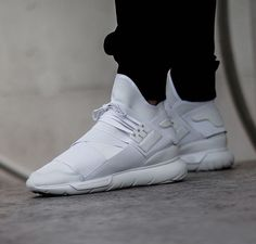 Stepping in to the future with the all white Qasa High. Purchase in retail and on Y-3.com. Image by @asphaltgold_sneakerstore #adidas #Y3 #Qasa #triplewhite