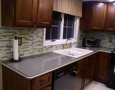 Here is a beautiful kitchen done in the Bella Glass Tiles Random Brick Series Rosemary Green . Beautiful Kitchens, Tiles, Kitchen Cabinets, Metal Tile, Kitchen, Kitchen Backsplash Inspiration, Brick, Glass Tile, Glass