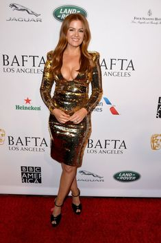 Isla Fishers attend The BAFTA Los Angeles Tea Party at Four Seasons Hotel Los Angeles at Beverly Hills on January 2019 in Los Angeles, California. Beautiful Female Celebrities, Girl Celebrities, Beautiful Actresses, Celebs, Beautiful Women Over 50, Beautiful Redhead, Isla Fisher Wedding Crashers, Golden Dress, Cheryl Cole