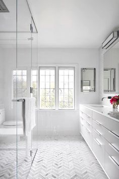 Bright White Bathrooms are clean, minimalist, romantic, and larger than life when well-designed. Bathrooms should be designed with total relaxation in mind!