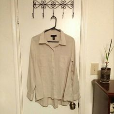 Khaki colored blouse Lightweight khaki-colored button-down blouse with two front shirt pockets. The front bottom hem rises just slightly higher than the back hem. Style & Co Tops Button Down Shirts