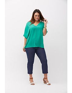 This dolman is definitely your next night-out tee. The crepe fabric and cuffed sleeves dress it up, but the drapey fit and vented sides keep it comfy. V-neck. lanebryant.com