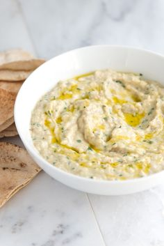 Making this baba ganoush recipe, an amazing roasted eggplant dip, at home is so simple. Serve with vegetables, sliced bread or baked pita chips. From inspiredtaste.net | @inspiredtaste