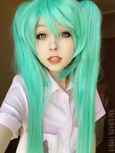 Beautiful Vocaloid C green wig. (http://www.uniqso.com/cosplay-wig-vocaloid-miku-c)  120cm long, super sleek & shiny, easy to brush & maintain.   Pigtails can be detached.  #vocaloidwigs #greenwigs