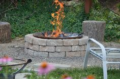 Retaining Wall Block Fire Pit.  36 Stones to complete.  Estimated cost $86 Bucks!  LOVE IT!