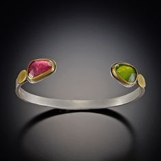Pink Tourmaline and Vesuvianite Cuff Bracelet | Ananda Khalsa Jewelry  |  Bright rose cut pink tourmaline and brilliant vesuvianite are accented with 22k oval disks on this silver cuff bracelet. 22k bezels. Hammered band is 6mm wide.  $1,265.00