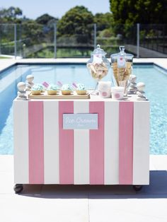 dessert table at pool party...but i'm talking about the painted pink/white balsa wood front panel made to cover the uglies! will be using this idea for a future party...