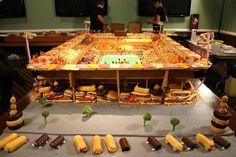 Two-story snackadium. And broccoli trees.   21 Incredible Football Stadiums Made Of Snacks