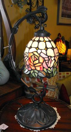 Stainglass dragonfly lamp...with a rooster in the background. $89.00