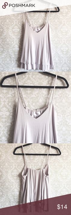 "Layered Flowy Camisole Light lavender/grey tone camisole top. Has flowy layers and a V neckline. Strap length is 15"", from top shoulder to bottom is 24"" and pit to pit is 16"". Very soft material made of 95% rayon and 5% spandex. Brand new with tags! Nymphe Tops Camisoles"