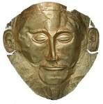 La maschera di Agamennone -1550-1500 a.C. circa -autore sconosciuto -luogo di ritrovamento: tomba V, cerchio A, Micene -luogo di conservazione: Museo Archeologico Nazionale di Atene -lamina d'oro lavorata a sbalzo
