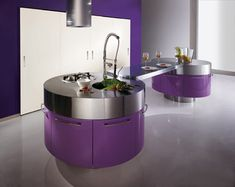 Permanent Link to : modern purple kitchen with cylindrical fan above stainless steel countertop
