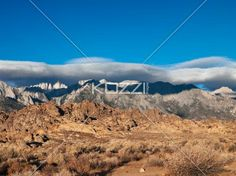 view of a mountain range with cloudscape in the background. - View of a mountain range in eastern sirrea with cloudscape in the background.