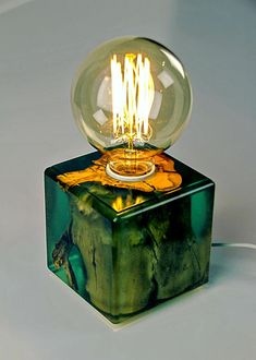 Lamp brings in a little bit of mystery. Clear resin with light green dye and white tree root is e great combo. Resin brings up all details in the wood. Finish: fine-polished epoxy and lacquer Shape: Rectangular Light: 40W, Warm Red Voltage: 230V, EU standard (can be adapted to US or UK