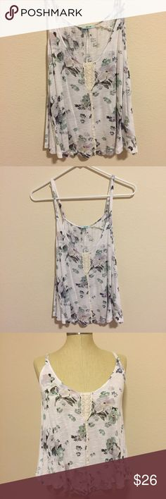 Urban Outfitters Floral Tank Cute ivory colored tank from Urban Outfitters! Crochet detail on the front. Floral design with green and very light purple colors. Brand is Kimchi Blue, size small and in excellent condition   No trades No modeling No ️aypal No Merc ✅Posh Rules ✅Use Offer Button ✅Bundle for 15% off Urban Outfitters Tops Tank Tops