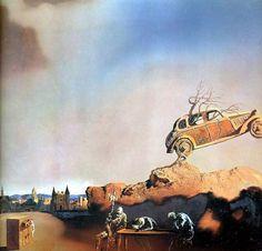 """Картина """" Явление города Дельфта"""" Сальвадора Дали.  На картине масса совершенно дзенских противопоставлений, образующих некую сеть противоречий и аллюзий. Огромное пространство неба, частью синее, закрыто занавесями влажных облаков, облака создают тень и одновременно пронизаны светом. Где-то идет дождь, но передний план картины — это песок. Сухой, коричневато-оранжевый песок."""