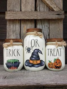 Set of three Halloween Masons! I hand painted each one of these after i chalk painted them. I sealed them all with a couple coats of clear satin sealer & added vintage canning bands on each one! These will make a perfect Halloween centerpiece with flowers in the jars, or could be used at a Halloween
