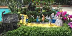 Miniature Fairy Garden - WIZARD OF OZ. This Miniature Garden has three scenes: Munchkin Land, The Forest and Emerald City. In Munchkin Land, Glinda, the good witch is talking to Dorothy about following 'The Yellow Brick Road' to Emerald City. The munchkins are very happy because the wicked witch of the east is dead; the baby munchkin on the bridge is crying because Dorothy and Toto will be leaving soon; two munchkins are walking to the house that dropped. 1/2016