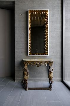 Fascinating Mirror...table is gorgeous too