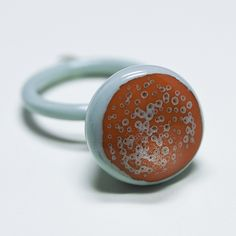 celadon and orange seed ring by Phlaznatch, via Flickr