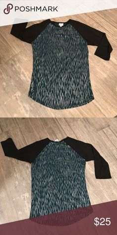 Holiday collection from lularoe Black sleeves; team and silver body - worn once LuLaRoe Tops