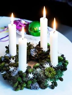 Advent wreath idea. Adding succulents would be just my sort of thing. Hmmmm.