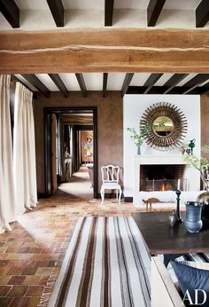Living Space With Tiles Floors A Large Area Rug And A Decorated Fire