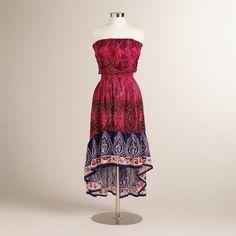 Bohemian Style Fuchsia Lalita Dress with a ruffled high-low hem and bold pink print.