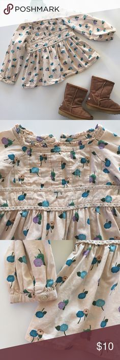 Baby Gap Floral Blouse Gorgeous long sleeve cream blouse with teal, lilac, and tan flower print.   It has a pleated chest, picot trim empire waist, button sleeves and zipper enclosure on the back.  Accessories not included. EUC GAP Shirts & Tops Blouses