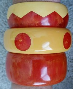 Watermelon and ivory vintage bakelite bracelets.