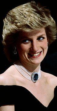 """Princess Diana  """"The seven-strand pearl choker that  stunned the world.""""  The large sapphire with two  rows of diamonds surrounding  it was originally a brooch, given to the Princess by  Queen Elizabeth, the Queen Mother as a wedding gift.  The Princess wore it as a  brooch on two occasions,  but decided to have it altered to be  the center piece of a pearl choker."""
