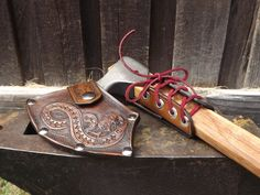 Viking Axe Head leather sheath by Beastman Caravan. http://www.deviantart.com/art/Axe-head-471430477