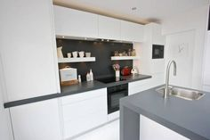 White handleless matt finish kitchen. www.kbstoretrade.co.uk