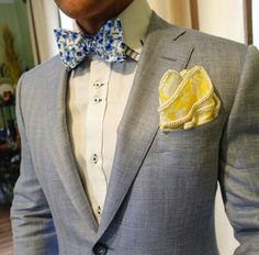 Gray suit yellow compliment