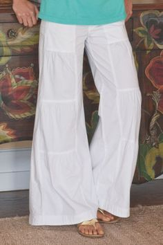 """Chic from top-to-bottom, this cleverly designed pant has a tiered inset on the front of each leg, creating a surprisingly flattering look. Also detailed with a flat drawstring waist, back elastic, front zip fly and side seam pockets. Comfy in soft cotton/spandex. Misses 30"""" inseam. Sits at natural waist. Terrace Pants #22752"""