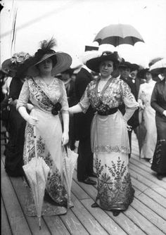 1910 stylish ladies in class and newer style gowns