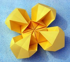 Origami: Fiore geometrico 2 - Geometric Flower 2. Origami from one uncut square of copy paper, 21 x 21 cm. Designed and folded by Francesco Guarnieri, August 2011.