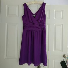 Banana Republic spring silky dress! This is from the retail store, not the outlet or factory store. It is a light weight silky medium purple dress. Hits around the knee, double v neck, flattering gathers at waist. Polyester. Fits true to size. Perfect for all occasions during the warmer months! Banana Republic Dresses Midi