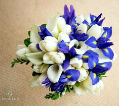 Beautiful Teardrop Wedding Bouquet Featuring: Blue-Violet/Yellow Iris, White Calla Lilies, White Freesia, White Tulips