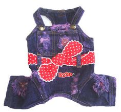 Heavily distressed pink blue jean denim, 100% Cotton overalls. Red and white heart pattern fabric is made in a bow around the waist, and lines the pockets and patches. Embroidery is all Betty Boop with custom Betty Boop jean snaps.