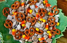Totally making this - Right Now! Candy Corn Snack Mix:   Melt 1 cup of semi-sweet chocolate   morsels, 1/2 cup peanut butter, 1/2     cup butter for 30 seconds at a time   until smooth.  Stir in 1 teaspoon    vanilla.  Pour over 9 cups of Chex    cereal and stir until coated.  Mix in    1 1/2 cups confectioners sugar and    coat.  Spread cereal on wax paper    and cool for 15 minutes.  In a large    bowl, mix cereal, 1 bag of candy   corn and 3 cups of pretzels.  Store   in a sealed…