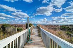 911 Ocean Blvd., Topsail Beach  With a covered porch and an open deck area on the oceanfront for sunny views outside and large windows in…