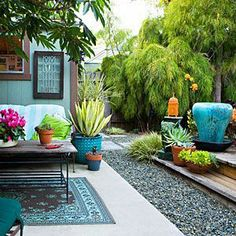 """Chic Backyard Ideas on a Budget Like the rug used to create outdoor """"living room."""""""