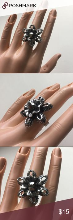 Brand-new big chunky adjustable ring silver flower Brand-new big chunky adjustable ring fashion jewelry for woman's and ladies. Black & silver. Flower 🌺 design. Check out my closet, we have a variety of Victoria Secret, Bath and Body Works, handbags, Aerosoles, shoes, fashion jewelry, women's clothing, Beauty products, home decors & more...  Ships via USPS. Don't forget to bundle, you save big! Always a FREE GIFT with every purchase!!! Thank you & Happy Poshing!!! Jewelry Rings
